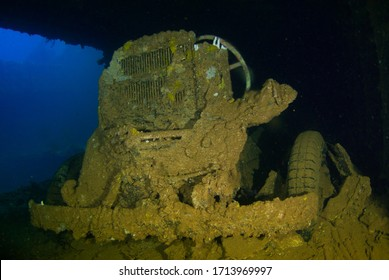 The rusting remains of a truck shot underwater in the cargo hold of a sunken ship. The vessel that held this cargo was a second world war Japanese ship that was sunk in Chuuk Lagoon during conflict