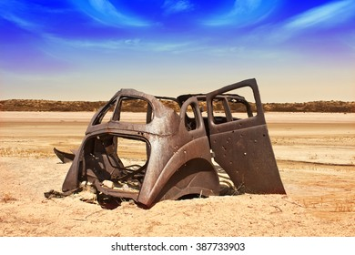Rusting vintage car in Desert