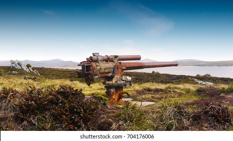 Rusting world war 2 naval mounted gun relic at Ordnance Point on a minefield from Falklands War on East Falkland Island, Falkland Islands.