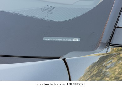Rustington, West Sussex / United Kingdom - August 1st 2020 : A Vehicle identification number on glass windscreen of a modern car. Close up view