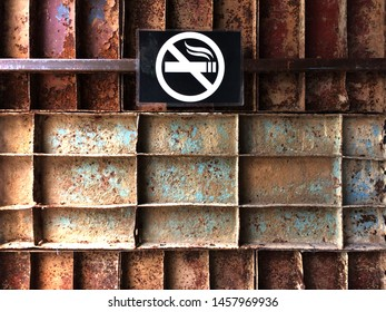 Rust-proof steel box compartment , Rusty wall texture construction background and no smoking sign