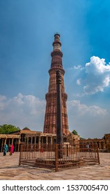 """The rust-resistant  IRON PILLAR of Delhi is a structure 23 feet 8 inches (7.2 metres) high with 16 inches diameter that was constructed by a """"King Chandra"""", overlooking the Qutb Minar."""