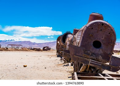 Rusty abandoned old trains in the train cemetry at Uyuni desert in Bolivia