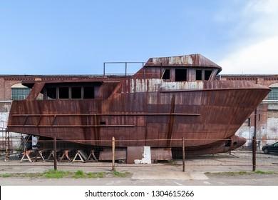 Rusty, abandoned ship under construction