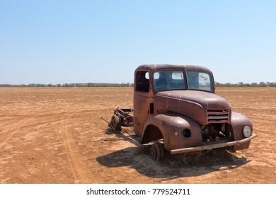 Rusty abandoned truck in dry landscape in Queensland, Australia