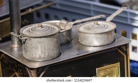 Rusty aluminium frying pans and saucepans on a kitchen stove