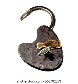 Rusty antique padlock of brown metal opened on white background with key