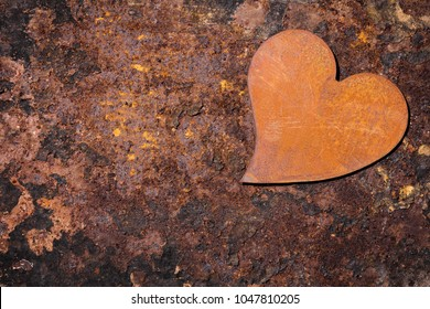 rusty background with rusty heart, copyspace for own text