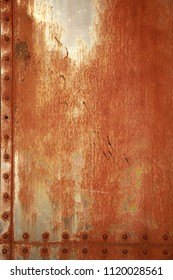 Rusty background with rivets. Vertical