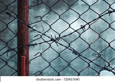 rusty barbed wire with grunge wall background