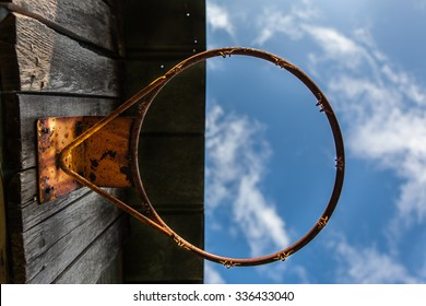 Rusty barn basketball hoop