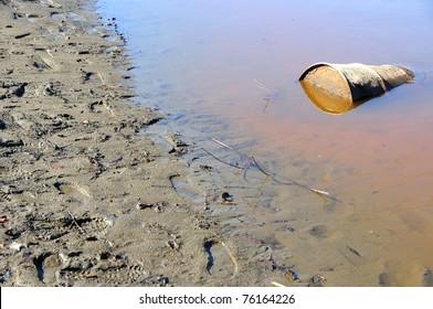 Rusty Barrel Pollutes River