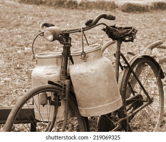 Rusty bike of a milkman of the last century with the bins for the delivery of fresh milk