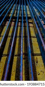 Rusty blue purple metal and its shadows on floor - Shutterstock ID 1938847153
