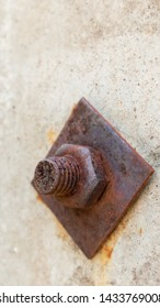 Rusty bolt with a nut in the mounting post is close