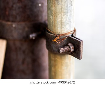 Rusty Bolt and Nut with Wire