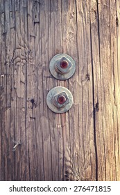 Rusty Bolts on Wooden pole