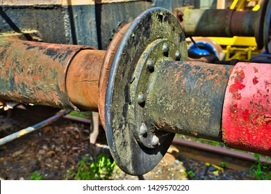The rusty buffers of two old railway cars collide