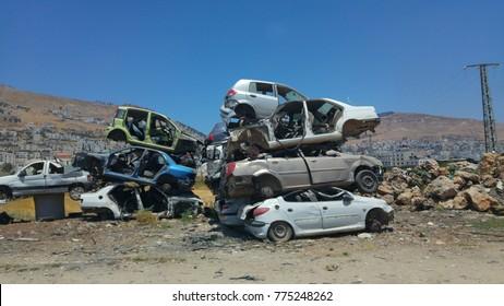 rusty car in desert of palestine