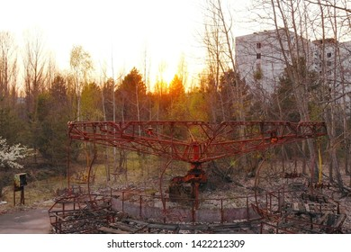Rusty carousel in the amusement park of the city of Pripyat, Abandoned deserted city after a nuclear disaster. City of Pripyt near Chernobyl nuclear power plant. Ghost city near the Chernobyl NPP.