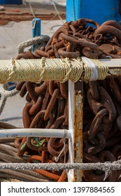 Rusty chain piled on fishing boat deck