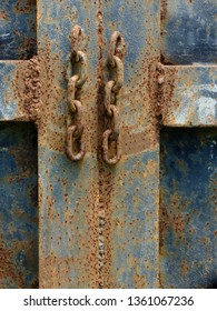 Rusty chains exposed to sunlight.