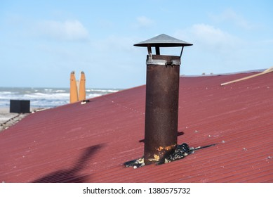 rusty chimney on the roof