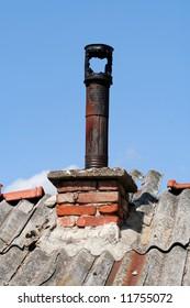 Rusty Chimney under blue sky