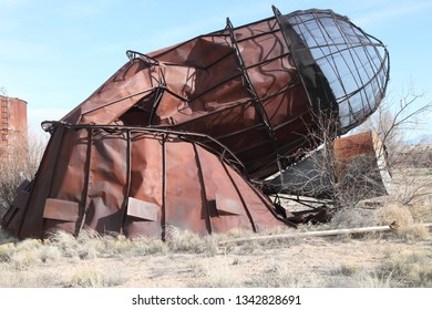 A rusty and collapsing industrial incinerator in an abandoned industrial park in central New Mexico