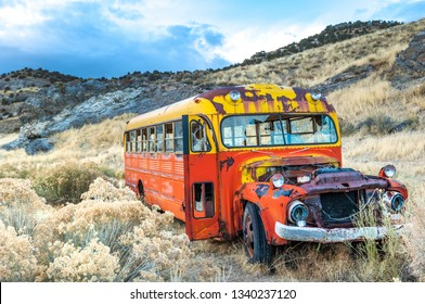 Rusty colorful old bus in Nevada ghost mining town, USA