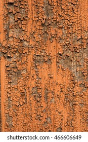 rusty coloured cracked paint peeling and decaying on wood texture