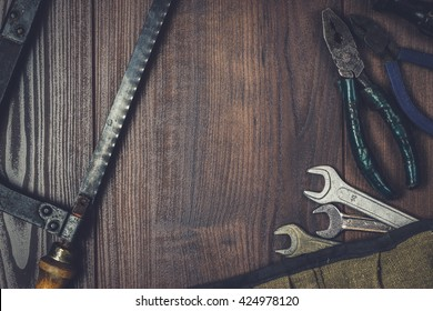 rusty construction instruments on the wooden background