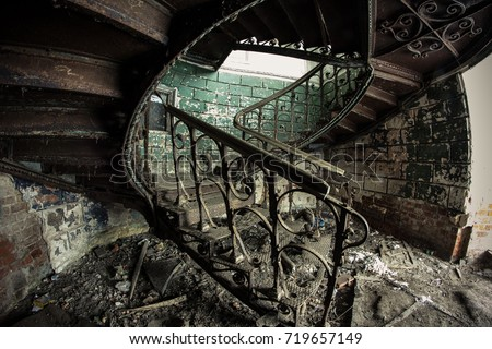 Rusty Decorated Vintage Spiral Staircase In Abandoned Mansion