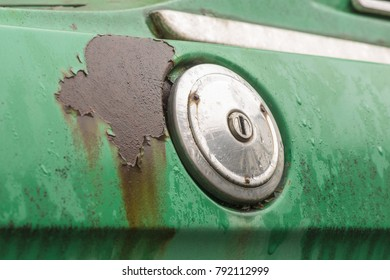 Rusty and dirty gasoline filler cap of a vintage car in retro design.