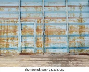 Rusty door of abandon factory.
