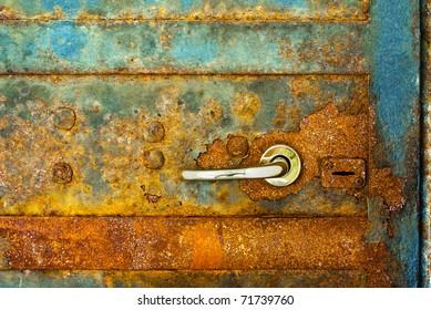 rusty door with shiny heck