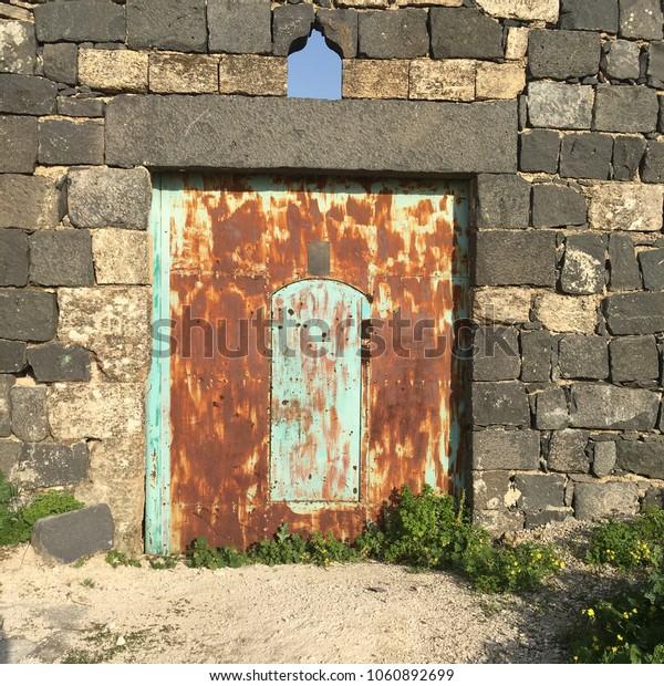 Rusty door in Umm Qais, Jordan