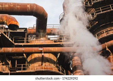 Rusty factory detail with smoke.