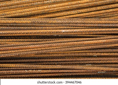 Rusty ferro concrete construction steel building armature as background