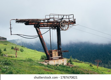 Rusty final station of the lift on the famous ski slope in Hruby Jesenik on the mountain Vysoka hole. Very run down station. A rusty and devastated column is waiting to be renovated. Ski resort - Shutterstock ID 1787670821