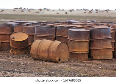 Rusty fuel and chemical drums in the Arctic