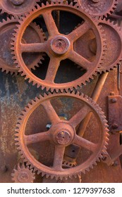 Rusty gears of old farm equipment machinery metal grunge texture background