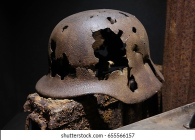 A rusty German World War II military helmet Pierced with bullets, remnant of the Battle of the Bulge, found in the ardennes.