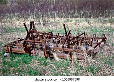 Rusty harrows on a field