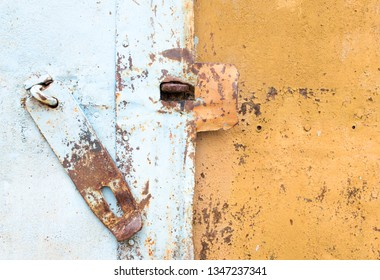rusty hinge on the garage door. deadbolt on the door