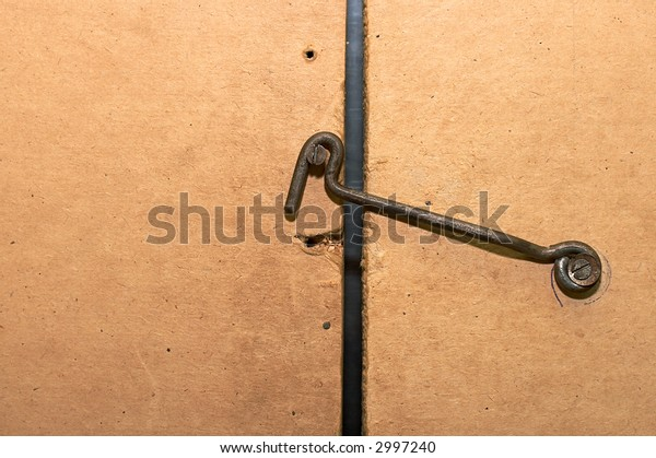 Rusty hook from a wire and the closed door