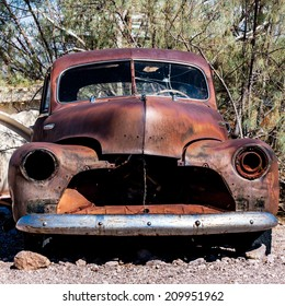 A rusty hulk of a car in the Nevada desert