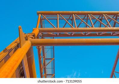 Rusty industrial steel construction below a blue sky