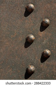 rusty iron bar with rivets