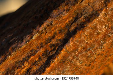 Rusty iron exposed to decades of salty air and sea water tidal changes.